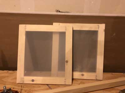 two finished DIY screen printing screens.